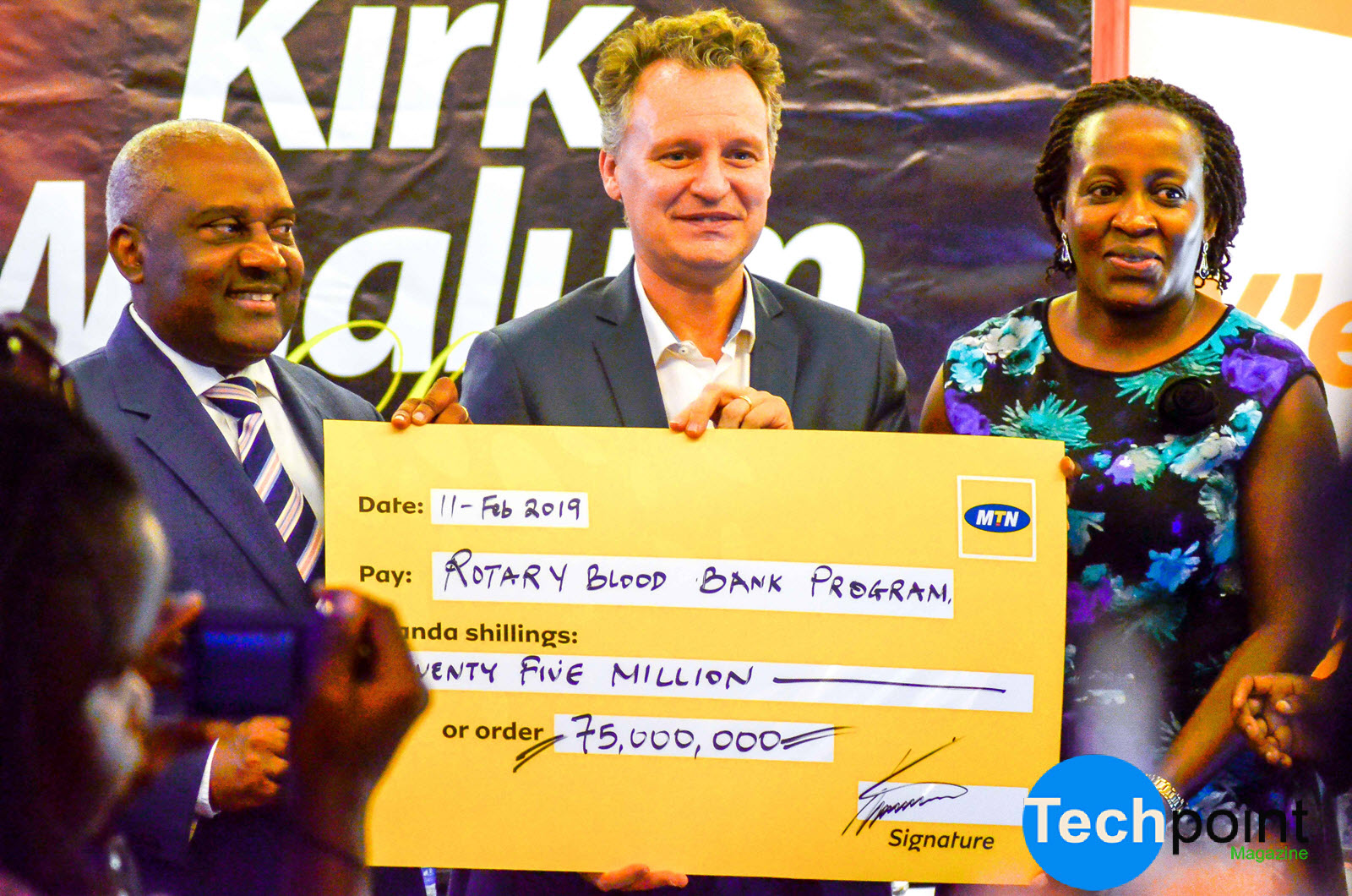 MTN CEO Wim Hands over a cheque to the Rotary blood Bank
