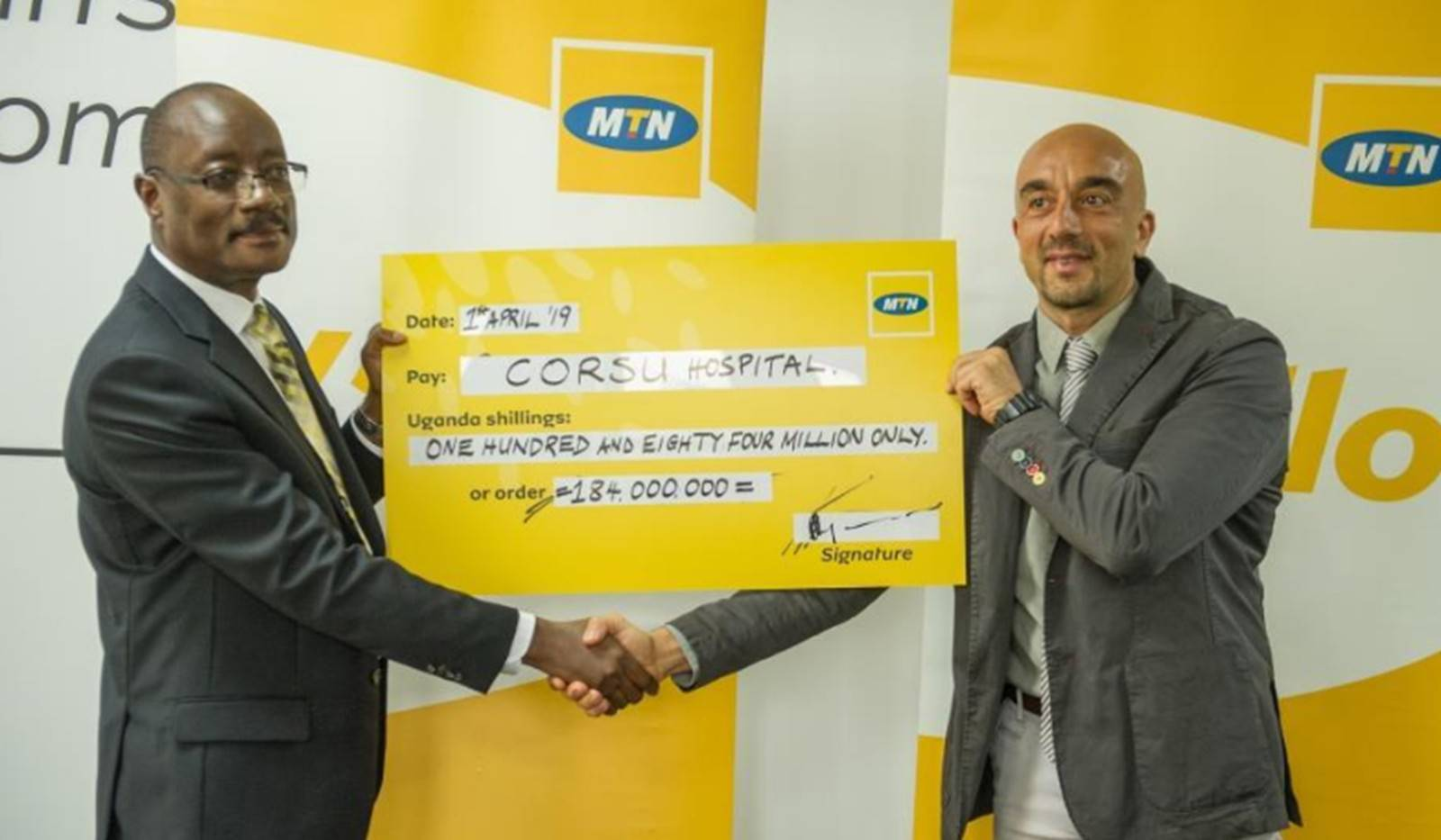 mtn ceo hands over a UGX 184 cheque to corsa